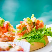 picture of antipasto  - Fresh homemade crispy Italian antipasto called Bruschetta topped with tomato - JPG