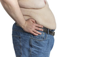 pic of bulging belly  - Shirtless overweight Man in blue jeans with hands on his hips isolated on white background - JPG