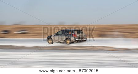 Blue subaru Legacy on ice track