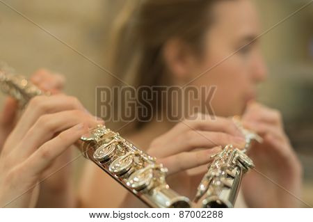 Fingers On Flute With Blurred Face