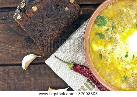 National Ukrainian And Russian Soup Borsch With Sour Cream In Ceramic Bowl With Black Bread On Woode