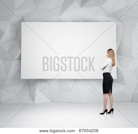 Businesswoman Is Looking At The Whiteboard In Office Space