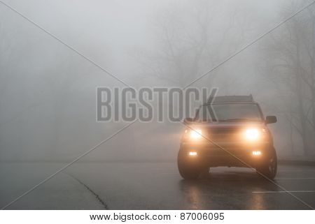 Medium Shot Of Suv Lights In The Fog