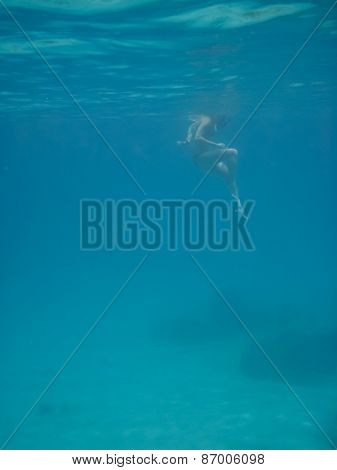 Wide Shot Of Woman Snorkeler Looking Down