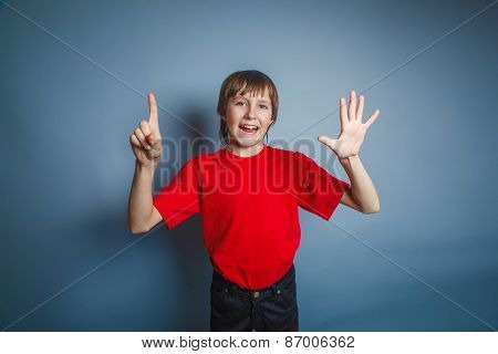 teenager boy brown European appearance in a red shirt shows the