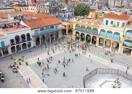 HAVANA,CUBA - MARCH 28,2015 : Groups of tourists visit the Old Square, one of Havana's most famous landmarks