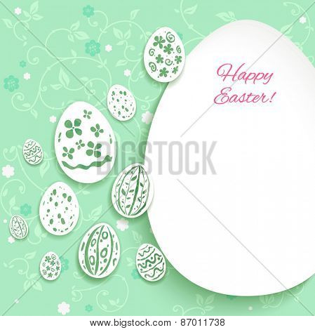 Easter decorative eggs on green background with place for text.