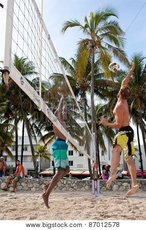 Man Leaps To Spike Ball In Miami Beach Volleyball Game