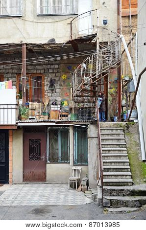 Tbilisi, Georgia-Feb,26 2015: Patio of an apartment house with spiral staircase. Tbilisi, Georgia