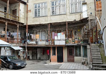 Tbilisi, Georgia-Feb,26 2015:Patio of an apartment house with spiral staircase in Tbilisi, Georgia