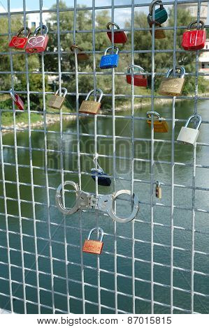 Padlocks Left By Lovers On Bridge In Ingolstadt, Germany.