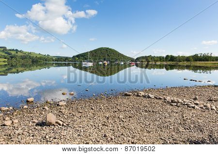 Calm peaceful relaxed morning on a still day at a beautiful lake with cloud reflections