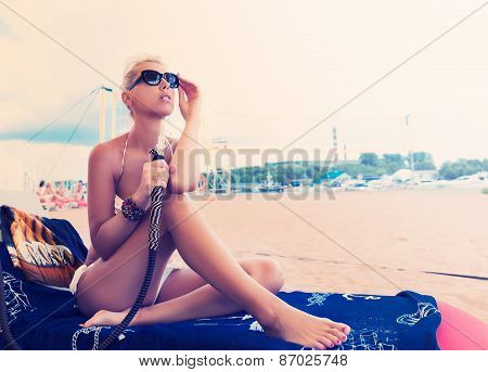 Woman With Hookah On The Beach In Bikini