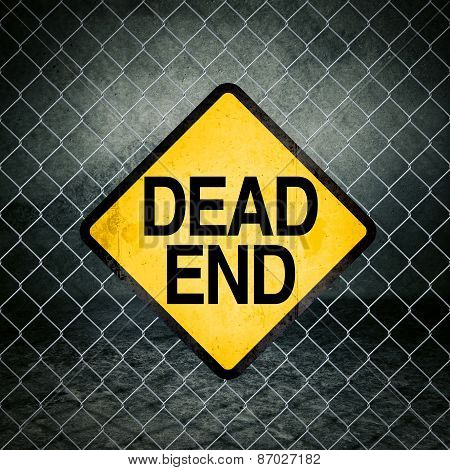 Dead End Grunge Yellow Warning Sign On Chainlink Fence
