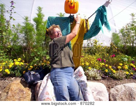 woman and halloween scarecrow