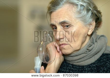 Woman making inhalation