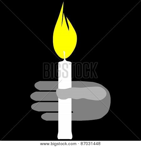 Hand with burning candle isolated on black background