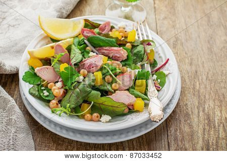 Assorted salad with arugula, spinach, chard, chicken,
