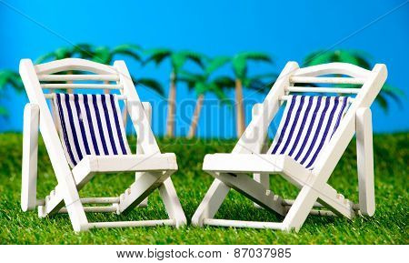 Two Small Sun Loungers On Grass
