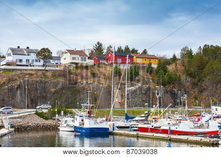 Norwegian Village, Wooden Houses And Fishing Boats