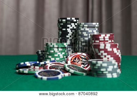 Colourful Poker Chips On Green Background With Copy Space