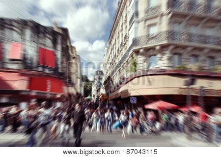 Abstract Background.  Blurred Crowd In  Paris - Radial Zoom Blur Effect Defocusing Filter Applied, W