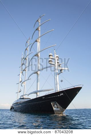 Gigantic big sailing boat or yacht in the blue sea.