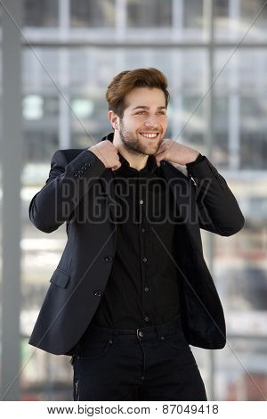 Cool Male Fashion Model With Beard And Black Suit