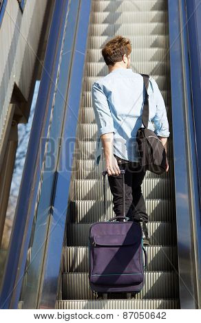 Travel Man Standing On Escalator With Bags