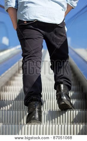 Low Angle Man Standing On Escalator