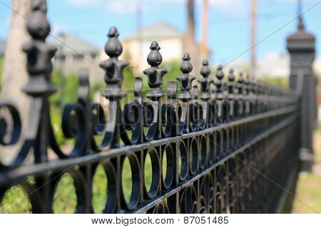 Very Narrow Dept Of Field Focus On The Iron Fence