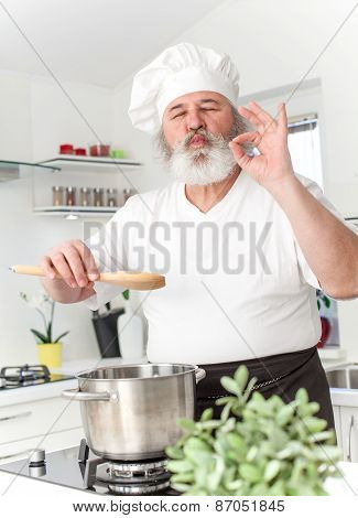 Elderly male chef in kitchen