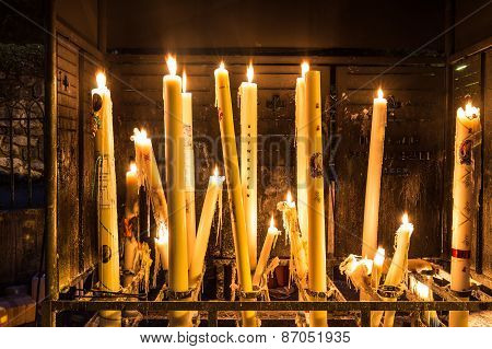 Specially Crafted Candles Burning In Lourdes