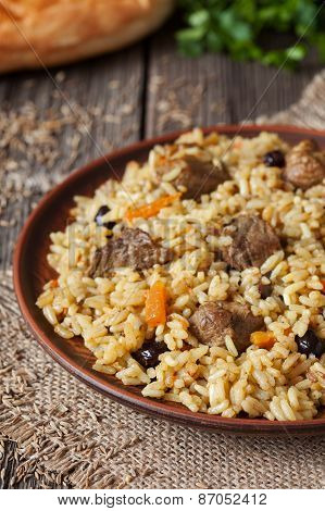 Traditional arabic spicy rice food with meat, onion carrot and garlic