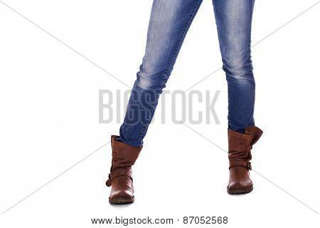 Brown leather female boots and blue jeans, isolated on white background