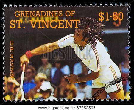 BEQUIA - CIRCA 1988: A stamp printed in Grenadines of St. Vincent shows Tennis Players Elie Nastase , circa 1988