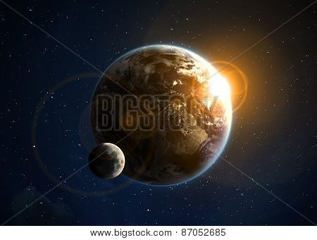 Earth with the rising sun. Elements of this image furnished by NASA