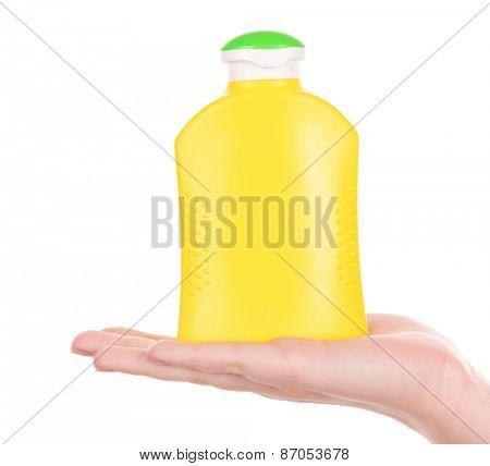 Bottle of suntan cream in female hand isolated on white