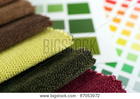 Scraps of colored tissue with palette close up