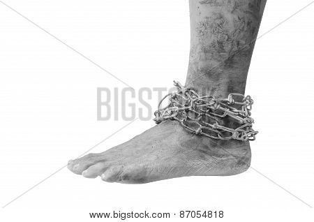 ankle of a man who was imprisoned by the chain.