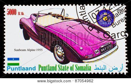 SOMALIA - CIRCA 2010: Postage stamp printed in Somali republic shows retro car, Sunbeam Alpine 1995,circa 2010.