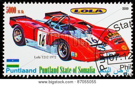 SOMALIA - CIRCA 2010: Postage stamp printed in Somali republic shows retro car,  Lola T212 1972,circa 2010.