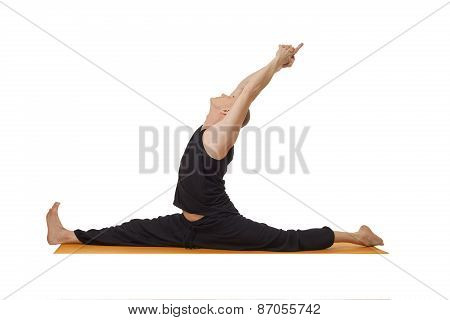 Yoga lessons. Middle aged man exercising in studio