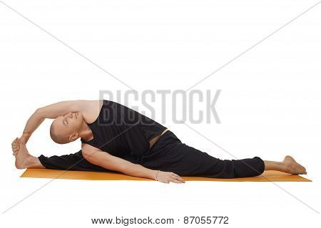 Studio shot of yoga instructor, isolated on white