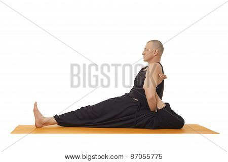 Yoga lessons. Flexible man posing at camera