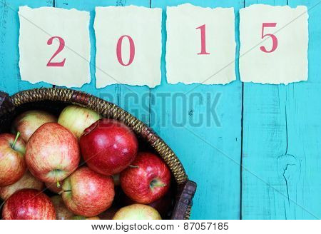 Basket of red apples by antique paper year 2015