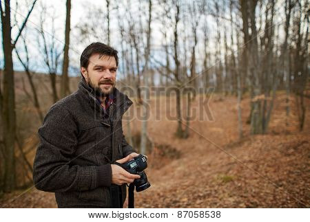 Young Tourist Taking Photos In The Forest