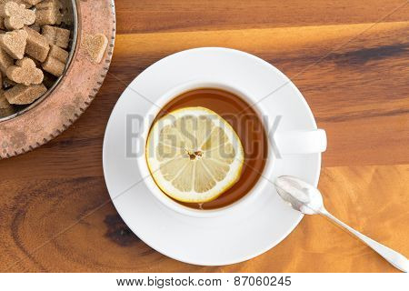 Cup Of Herbal Tea With Brown Sugar