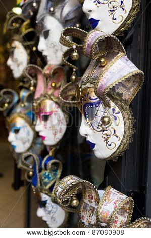 Various Venetian Masks Hanging Outside A Shop