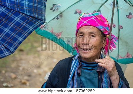 Hmong woman with umbrella